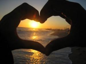 heart hands ocean